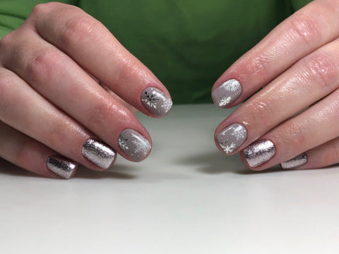 Beautiful winter manicure with snowflake nail decals and Glyanec leaf gel polish