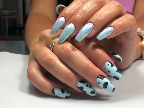 Beautiful Russian manicure with hand painted cow print