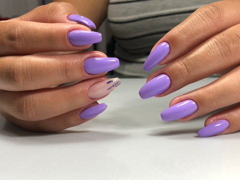 Russian manicure using purple gel polish and nail decals