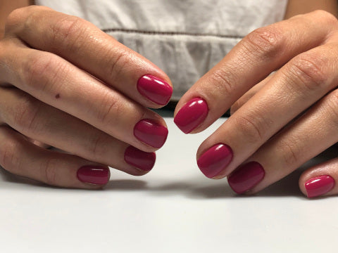 Russian manicure using red mauve gel polish