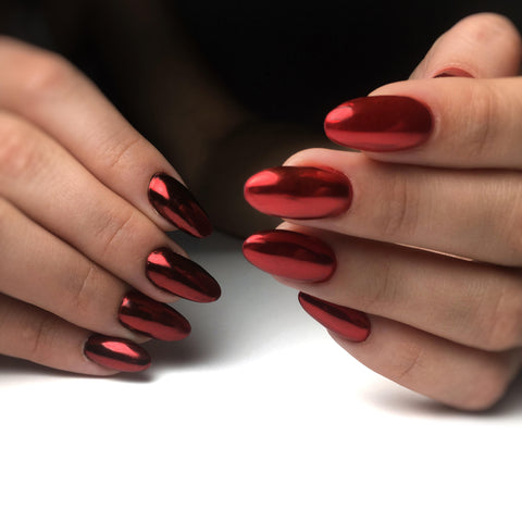 Beautiful red chrome nail powder used in machine manicure