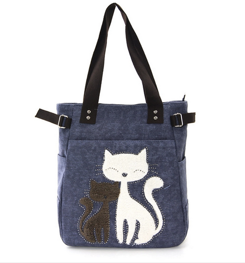 Kitties on blue canvas tote bag