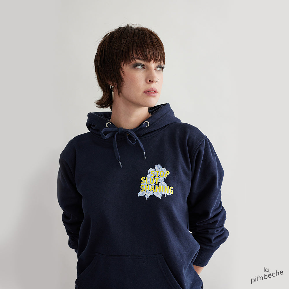 Stop Slut Shaming hoodie navy sweatshirt from artist La Pimbêche from Montreal How a woman dresses tells you nothing about how much she respects herself