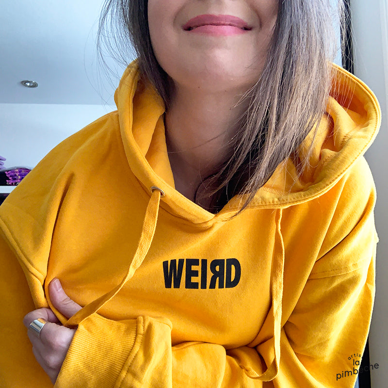 Yellow hoodie UFO happy faces It's weird not to be weird by the artist La Pimbeche from Montreal