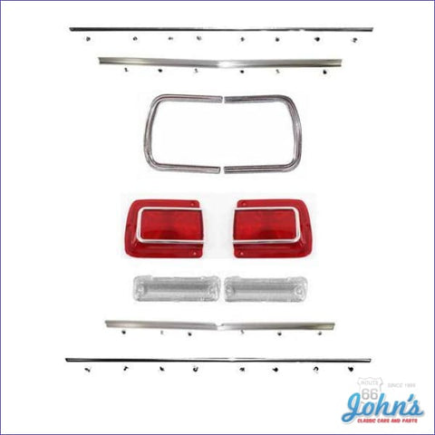 Rear Panel Molding And Bezel Kit With Tail Light Lenses Chrome. Includes Backup Lenses. (Os1) A