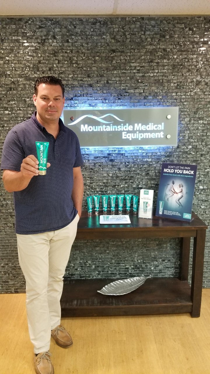 Mountain Ice Pain Gel Creator Marty Zarnock Jr holding a tube of Mountain Ice Gel. Mountain Ice has been replacing the use of opioids in long term care facilities.