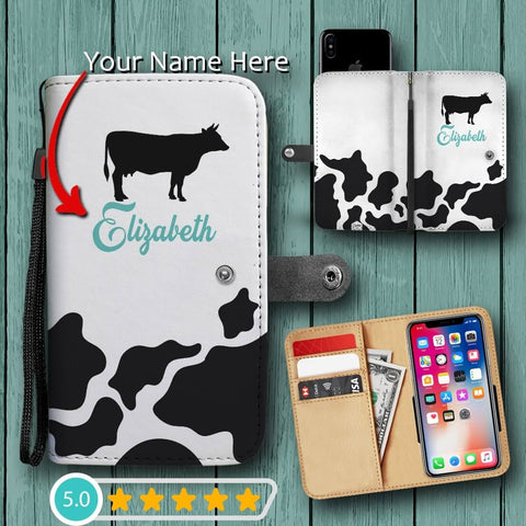 personalized cow print phone wallet case with your name on it. available in blue or purple text, customizable and personalized just for you