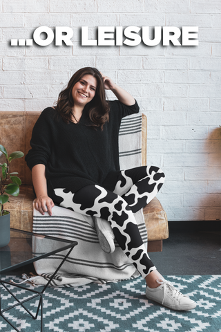 cow print leggings sitting on a coach