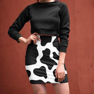 cool woman wearing Cow Print Mini Skirt and a black crop top| Cow Loco