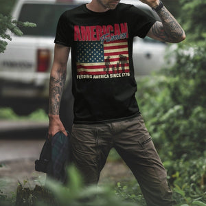 Man with tattoos ready for hunting wearing a shirt - American farmers feeding america since 1776 | Cow Loco