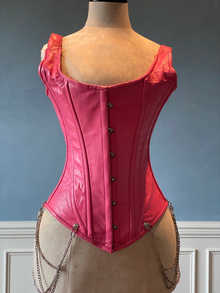 Salmon color leather corset with shoulder straps and chains. Steel-boned corset top for tight lacing.