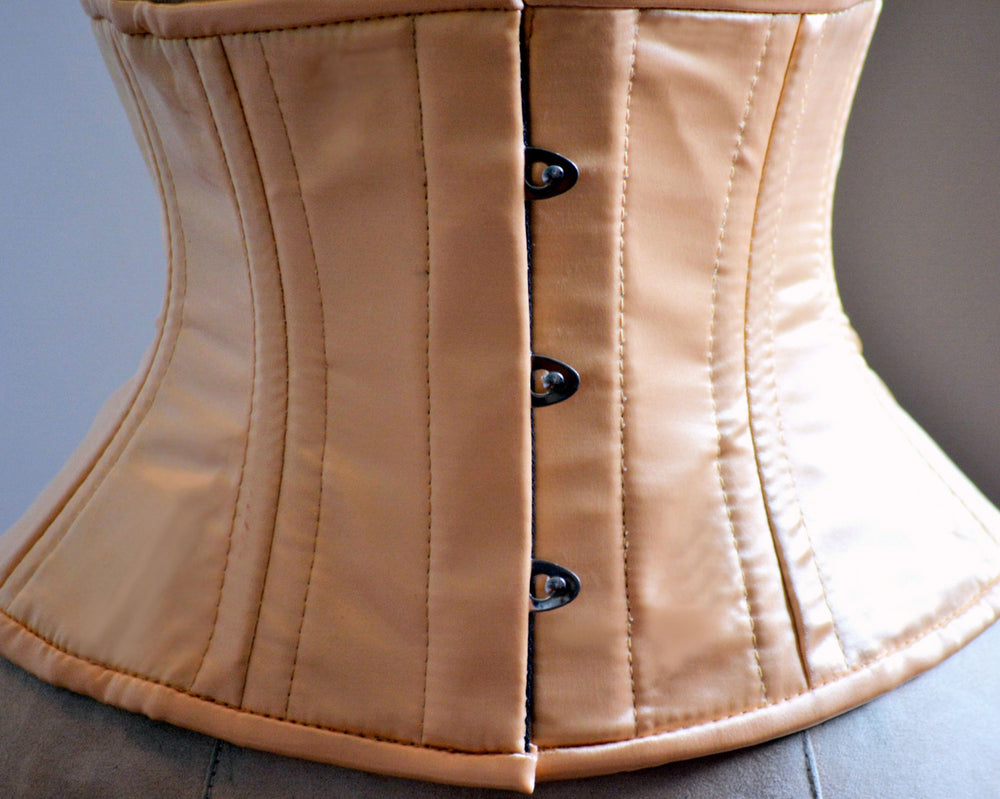 Short nude satin steelboned authentic waspie corset for tight lacing. Steel boned satin corset belt