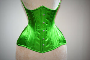 Real double row steel boned underbust corset from satin in a fashionable green grass summer color.