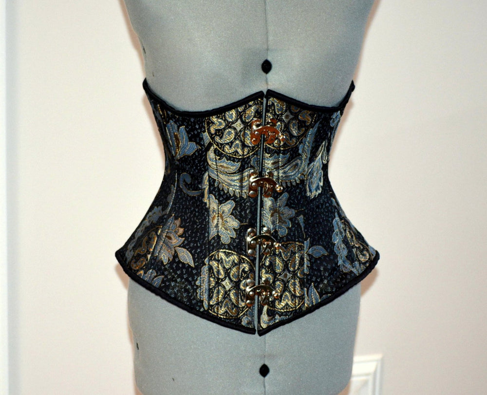 Steel boned underbust steampunk corset from brocade with golden pattern with steampunk hooks. Real waist training corset for tight lacing.