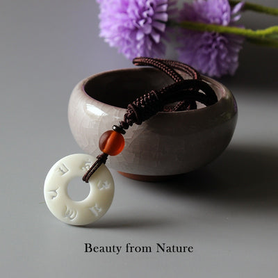 HANDMADE NECKLACE IN TAGUA NUT PENDANT WITH OM MANTRA SIGN