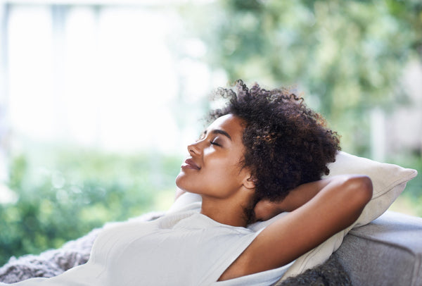 Shot of young black woman relaxing at home