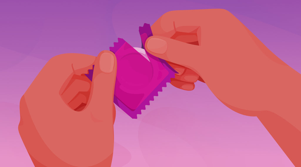 Two hands tearing open a condom wrapper