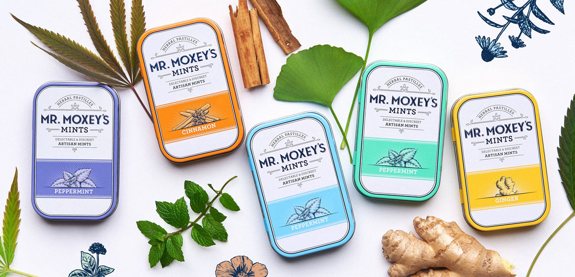 Five colorful tins of Mr. Moxey's various flavored CBD mints with the various herbs used in them.  Peppermint with Indian Gooseberry now being sold with more on the way.