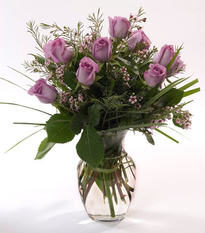 12 Premium Violet Roses in a Vase with Greens