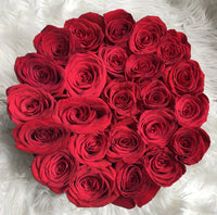 red roses in a round box, round box, round bloom box, red roses, flowers in black box, round flower arrangement