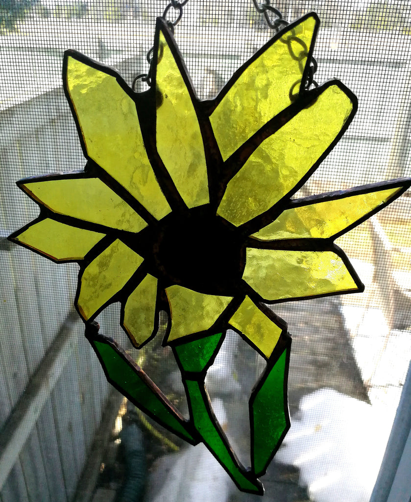 Yellow daisy in stained glass