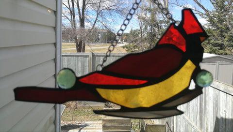 Red Cardinal in stained glass