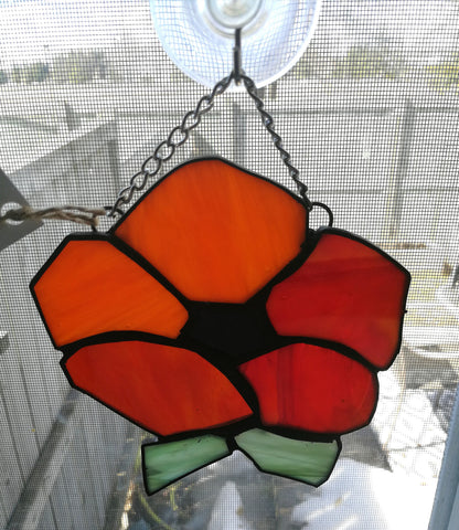 Orange and red flower in stained glass