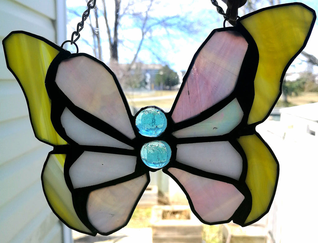 Yellow butterfly in stained glass
