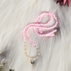 light pink necklace with dangling crystal