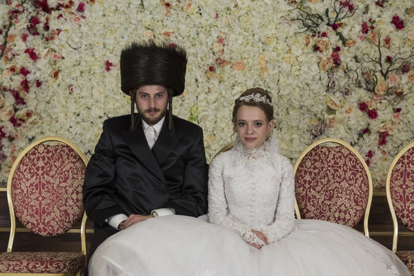 Esty and her husband Yanky who wears a Shtreimel and Payot