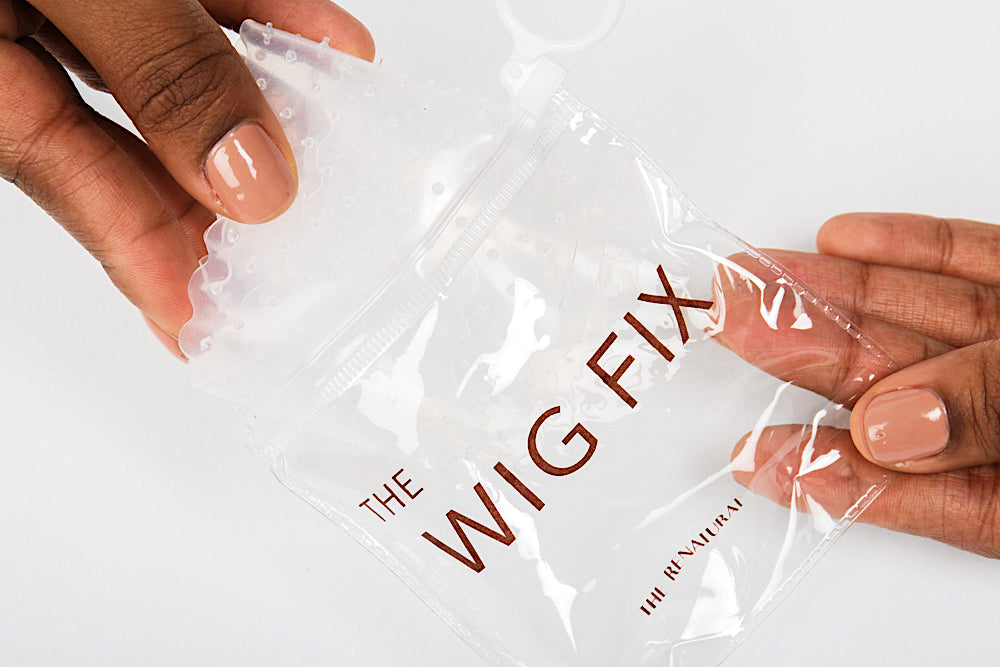 The Wig Fix being taken out of its packaging.