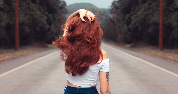 Woman With Red Hair Standing On Road