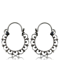 Intricate silver hoops