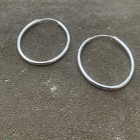 Oval hoop silver earrings