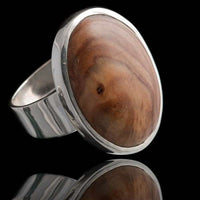 Oval Shaped Olive Wood Set In Silver Ring - Tribu
