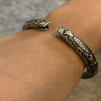 Sterling Silver Mei Long Cuff | Two Dragon's heads with tiny bells in their mouth  closing a circular hand cuff