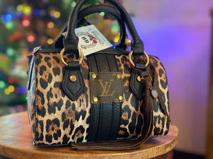 LV Cheetah Clutch Purses