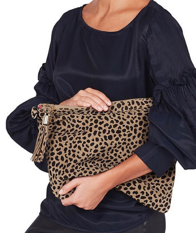 close up of woman wearing black clutching leopard print slouch bag from Baby mac shop