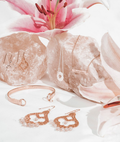delicate boho jerellery on display upon large piece of rose quartz by Styling You the Label