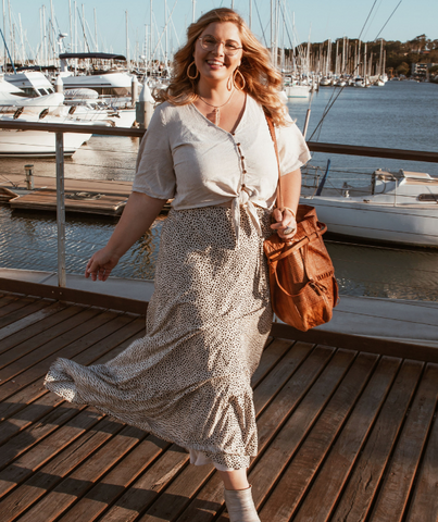 Jess Krause models the ada + lou all Willow skirt unnatural while walking along sunlit marina