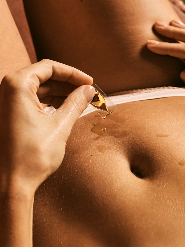 menstruation cbd liquid applied on a woman belly