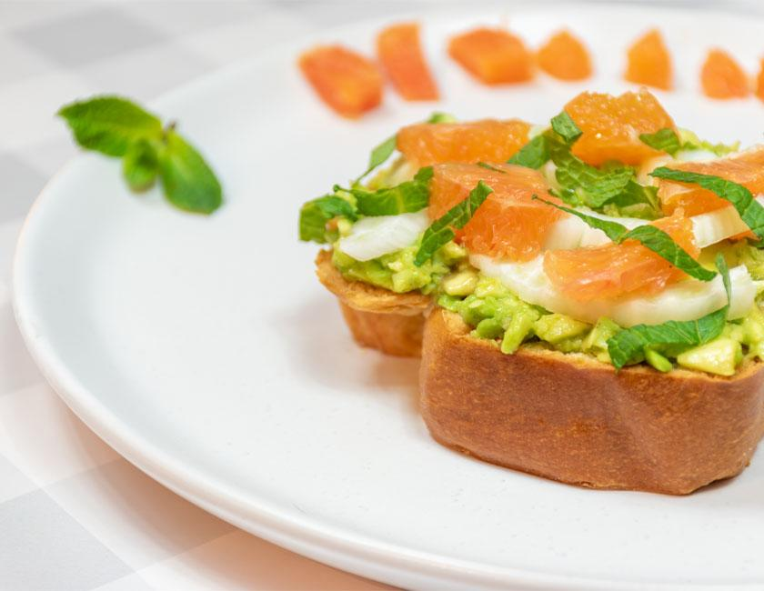an avocado toast with citrus suprèmes & slivered fennel on bakerly hand braided brioche