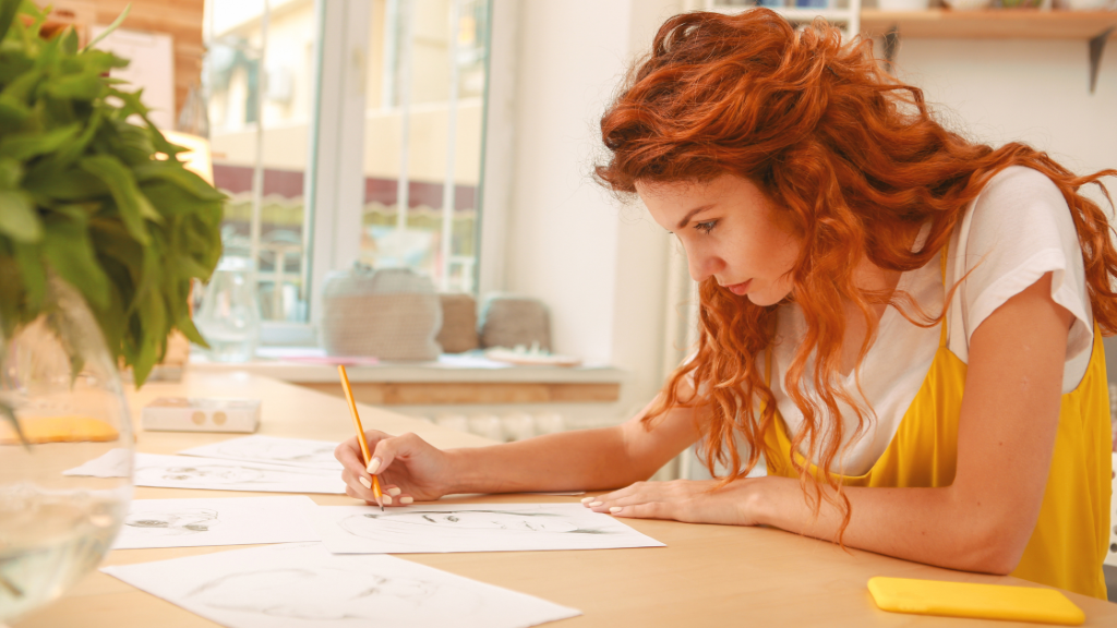 Woman sitting at table coloring