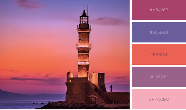 Lighthouse with coral and purple sunset