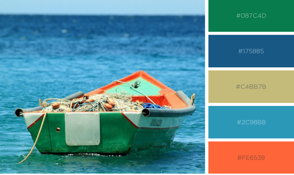 Teal and orange fishing boat in ocean waters