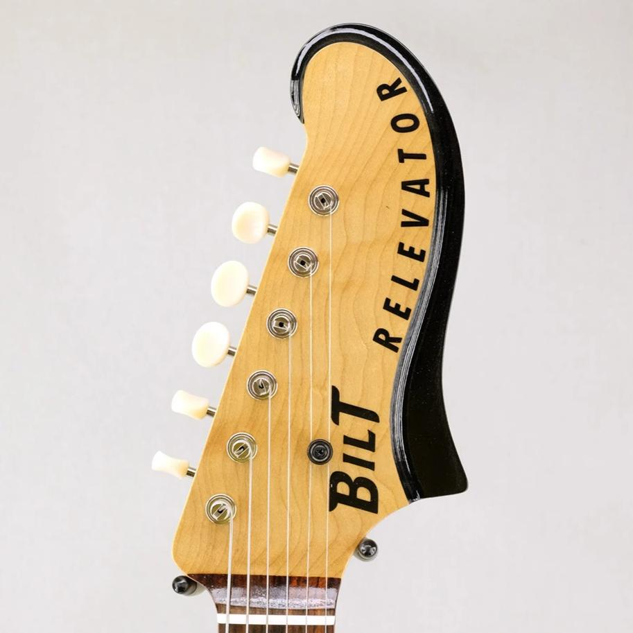 "Black Relevator ""Shop Piece"" Headstock Detail"