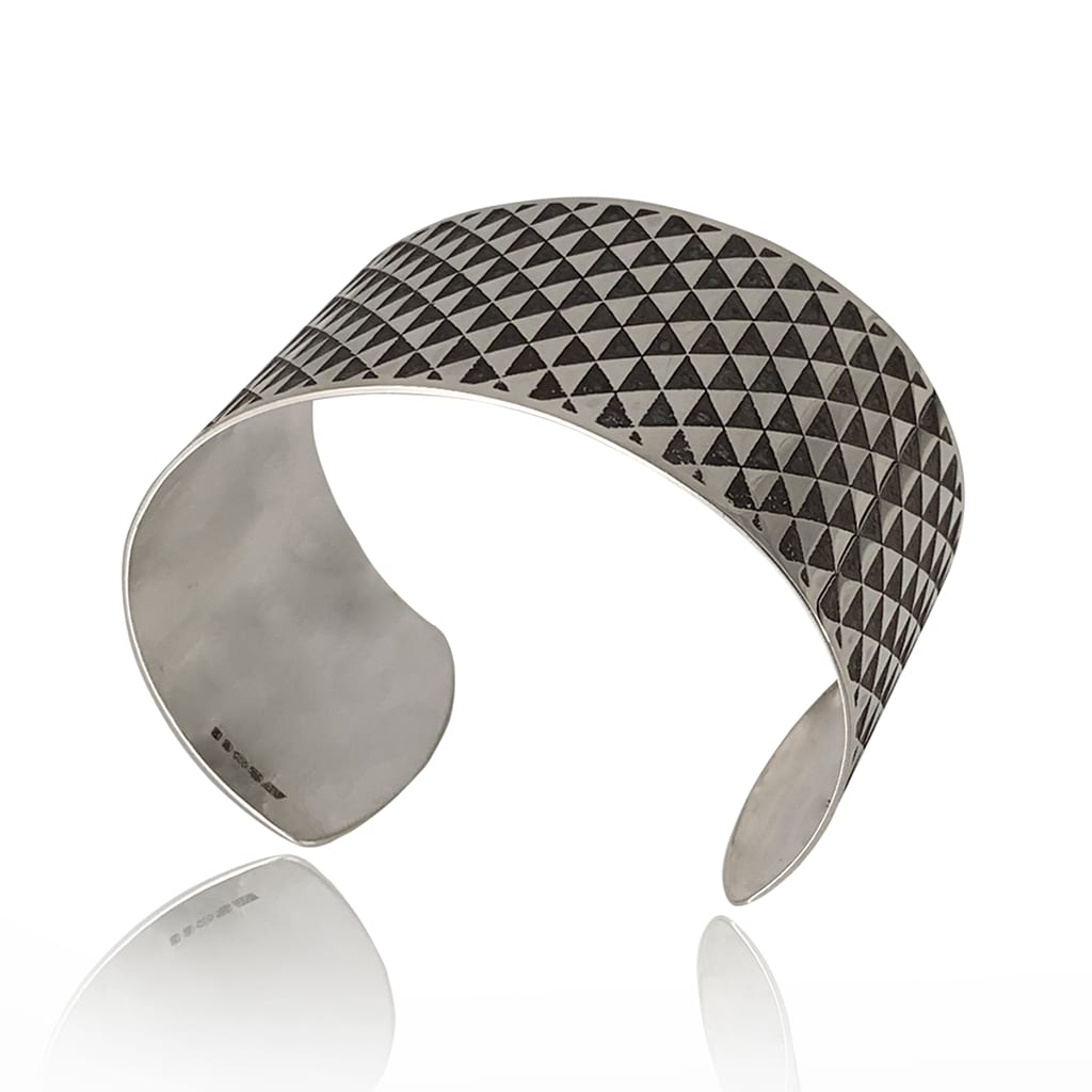silver cuff bracelet with triangle design