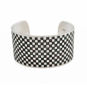 Chequerboard cuff oxidised medium top
