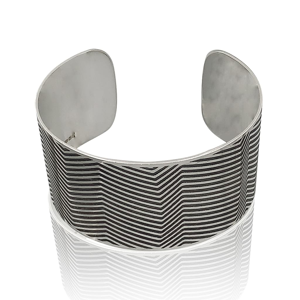 silver cuff with lines oxidised