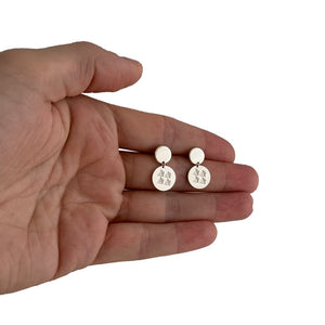 discs earrings on the palm of a hand